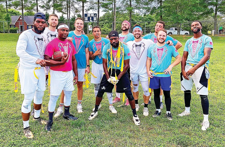 The You Thought (Crossfit Mayhem) team of, from left, Xavier Norman, Austin Auld, Darien Tubbs, AJ Wilkerson, Cameron Germanis , Demond Tubbs, Rich froning, Avery Jordan, Jeremy Adam Govero, Tony Vaughn and Bobby Norwood celebrate winning the Cookeville Flag Football League.