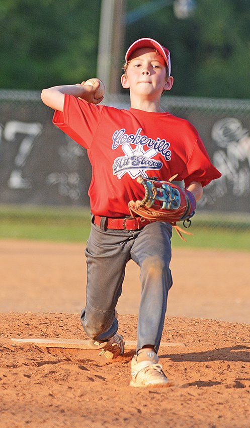 Cookeville Red's Riley Howell delivers a strike to a Warren County batter.