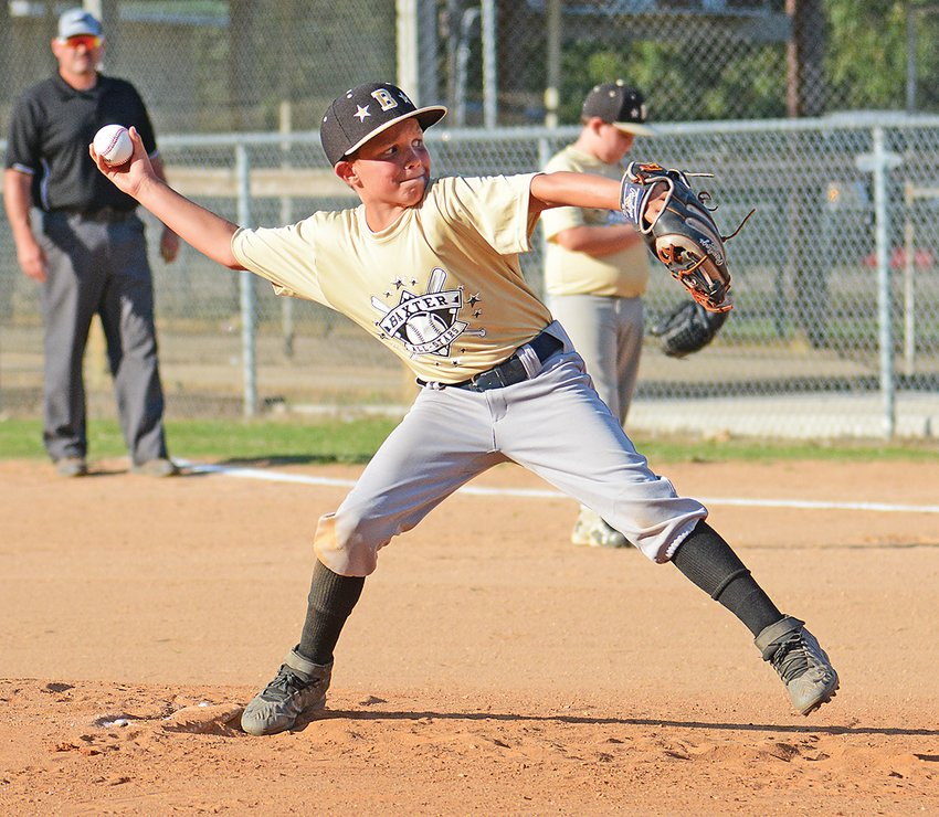 Baxter's Graham Davidson winds up to pitch against Cookeville Red Thursday at Jere Whitson.