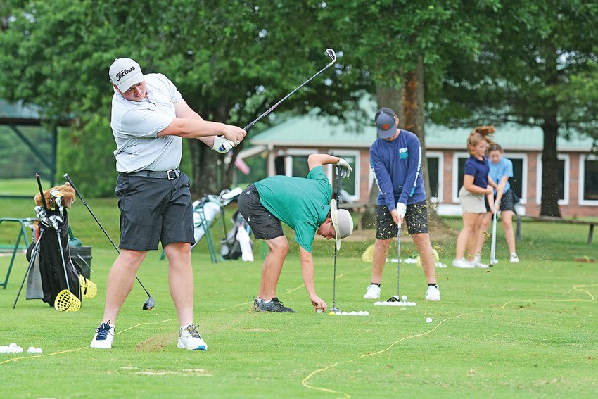 Upperman's, from left, Jared Greenwood, Braden Perry, Aiden Wyatt, Bryanna Herron and Maggie Watts warm up for their first practice round at Southern Hills Golf Course.