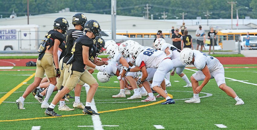 Pictured above, the Cavalier special teams prepares to block for an extra point attempt.