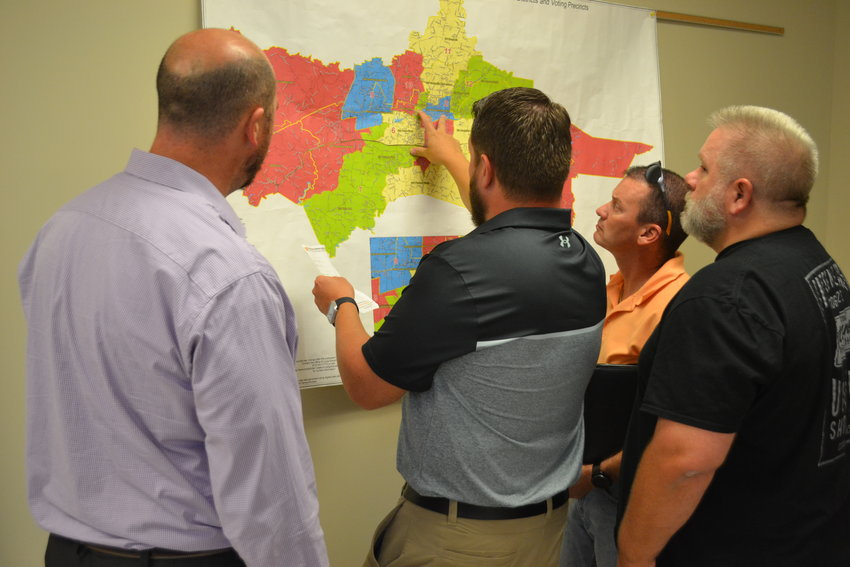 Ben Rodgers, center, a consultant with the County Technical Assistance Service, points out areas where district lines may have to be adjusted to Redistricting Committee members, from left, Tyler Asher, A.J. Donadio and Jonathan A.D. Williams.