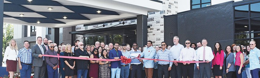 The new Holiday Inn opened its door to guests with a ribbon cutting ceremony. The new lodge offers a full-service restaurant as well as a roof-top bar. Owners in the front row are: Michael Gibson, CEO/Owner of Gibson Hotel Management Inc.; Dipti Patel; Kanal Shah; Chris Shah; Vansh Shah; Rajesh Patel; Yash Tanwar; and Nainesh Patel.