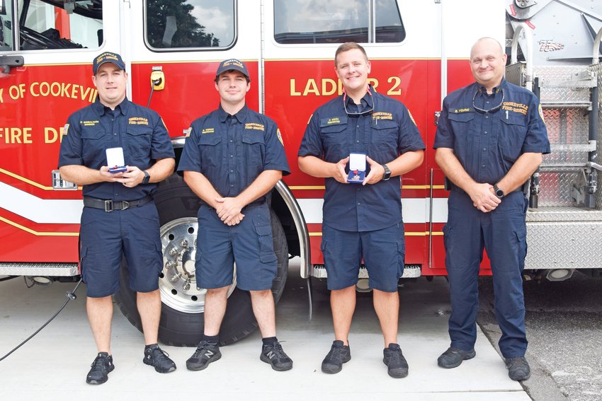 Cookeville Fire Department engineer Gage Bumbalough, left, firefighter Brent Keenan and firefighter Patrick South each received lifesaving awards Monday from interim CFD Chief Benton Young, right. Former CFD firefighter Nathan Barnes also received the lifesaving award.