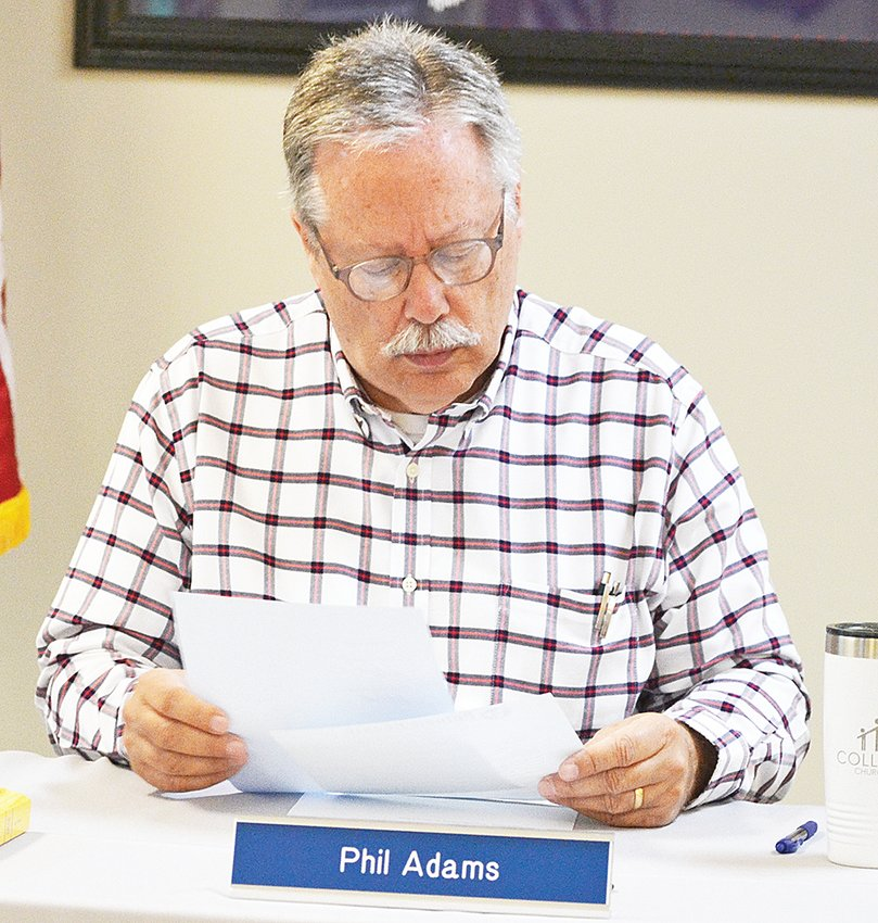 Putnam County Election Commission Chair Phil Adams looks over paperwork at Wednesday's meeting.