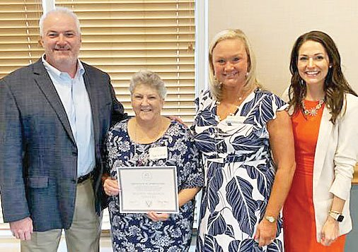 Celebrating 45 years as a member of the Cookeville-Putnam County Chamber of Commerce are Chuck Sparks, McGriff Insurance Services; Barbara Brown, McGriff Insurance Services; Leslie Loftis McGriff Insurance with chamber CEO Amy New.