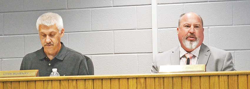 School board chair Lynn McHenry, left, listens as Director of Schools Corby King gives an update on a new school building.