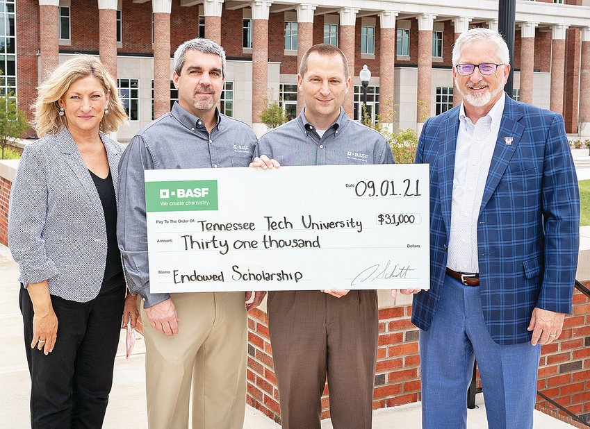 BASF presents a check, endowing a scholarship at Tennessee Tech. From left, Lori Bruce, Provost and Vice President of Academic Affairs at Tech; John DiCicco, BASF Production Manager; Andy Schmitt, BASF Site Director; and  Phillip Oldham, TTU President.