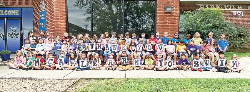 Second graders at Park View Elementary School offer a thank you after completing the Putnam County YMCA Learn to Swim program.