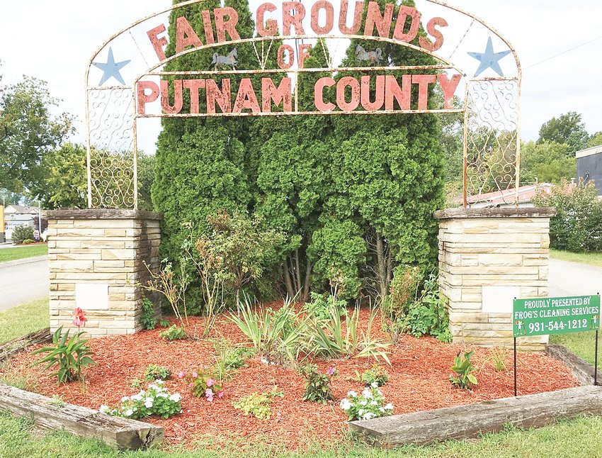 Jeremy Mountain, owner of Frog's Cleaning Service, has maintained the garden in front of the Putnam County Fairgrounds arch since 2015.