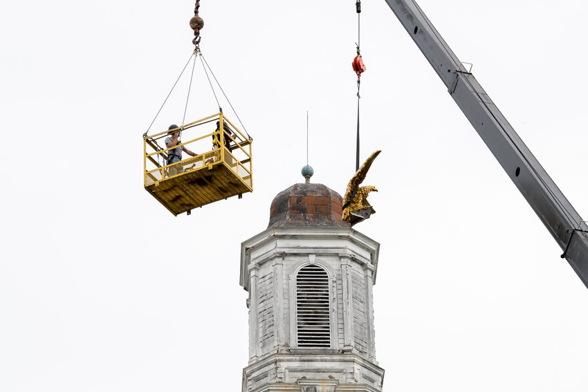 A crane removes Tech's golden eagle from its perch at Derryberry Hall for renovations.