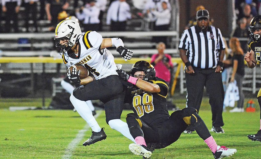 Upperman's Daniel Metzgar sheds a DeKalb County defender streaking through the middle of the field.