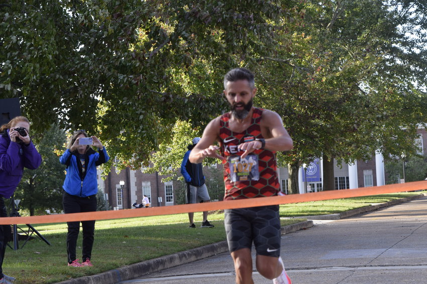 Michael England was the first one to cross the finish line Saturday at WCTE's Upper Cumberland Haunted Half marathon with a time of 1:17:16. The fundraiser for WCTE continues after the half marathon with the annual Blues and Brews craft beer and music festival at Dogwood Park.