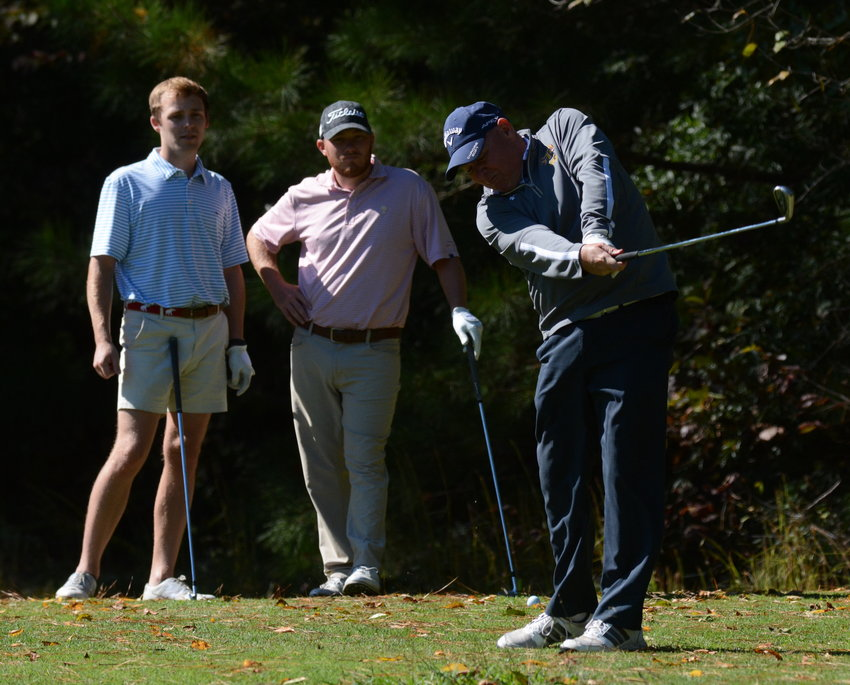 Sam Brooks, right, tees off during the 2021 Reels Cup at the Golden Eagle Golf Club