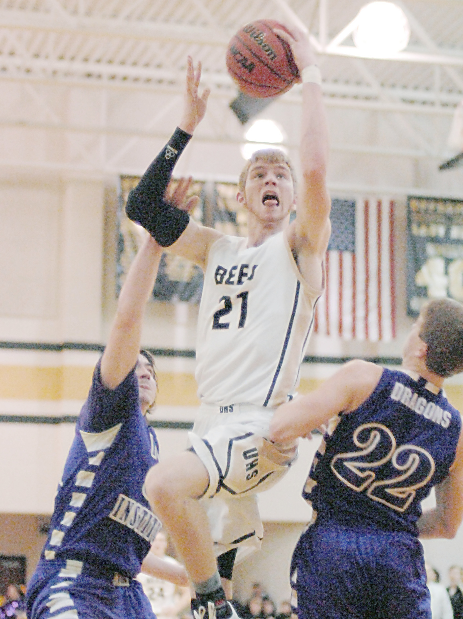 Upperman's Josh Endicott goes up for a layup during the Bees' 69 ...