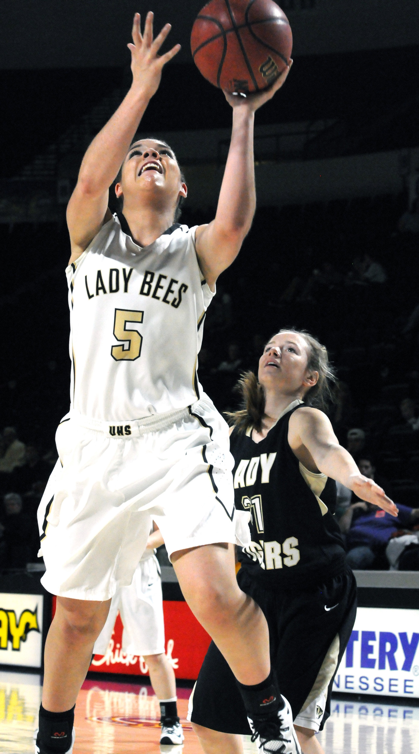 Upperman's Lexie Strickland (5) shoots a layup in front of DeKalb ...