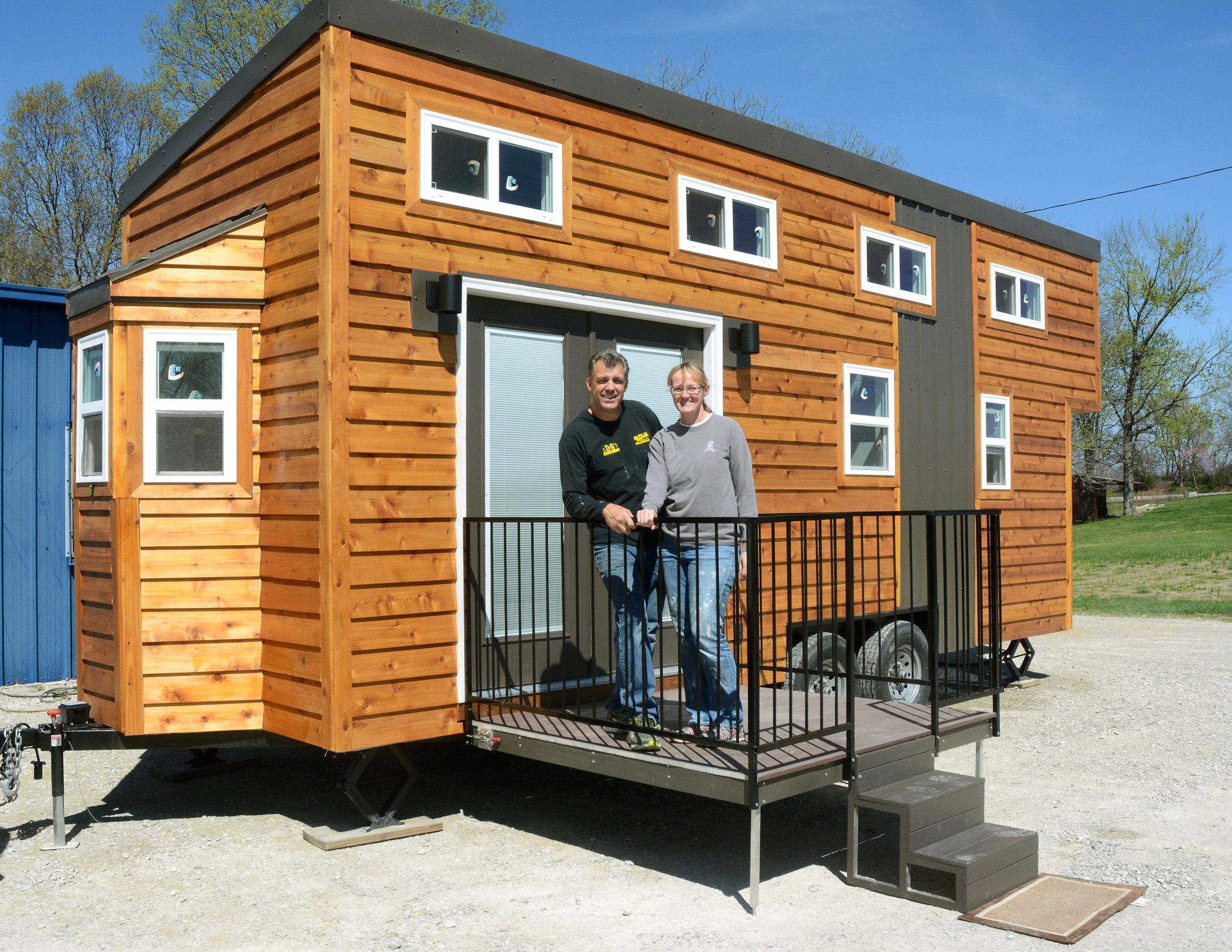 Don Duffield and Tanya Ward take a break from putting the finishing touches on their tiny house in preparation for the upcoming Tiny House Roadshow.