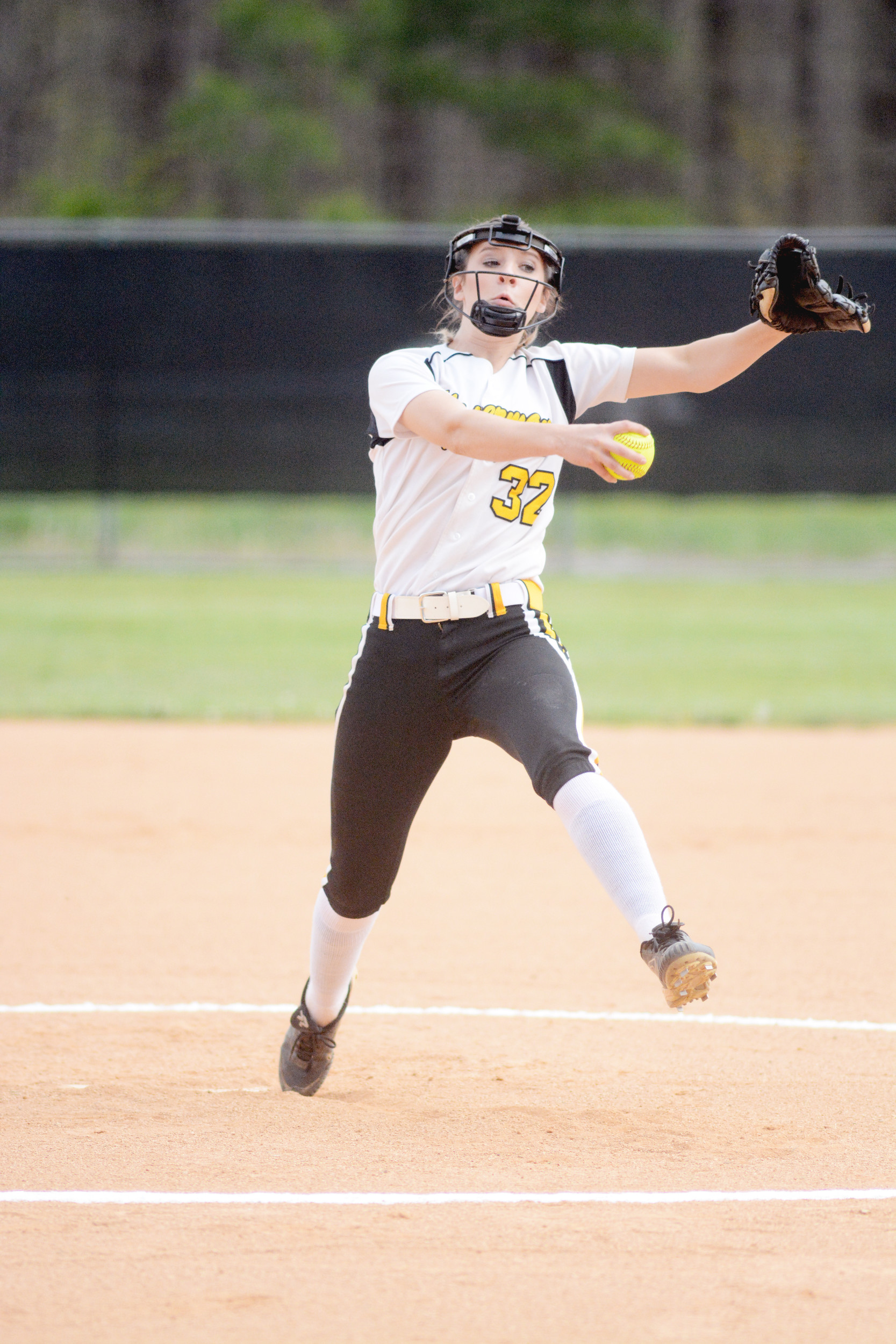 Upperman's Shelby Pullum throws to the plate during the Lady Bees' 1-...