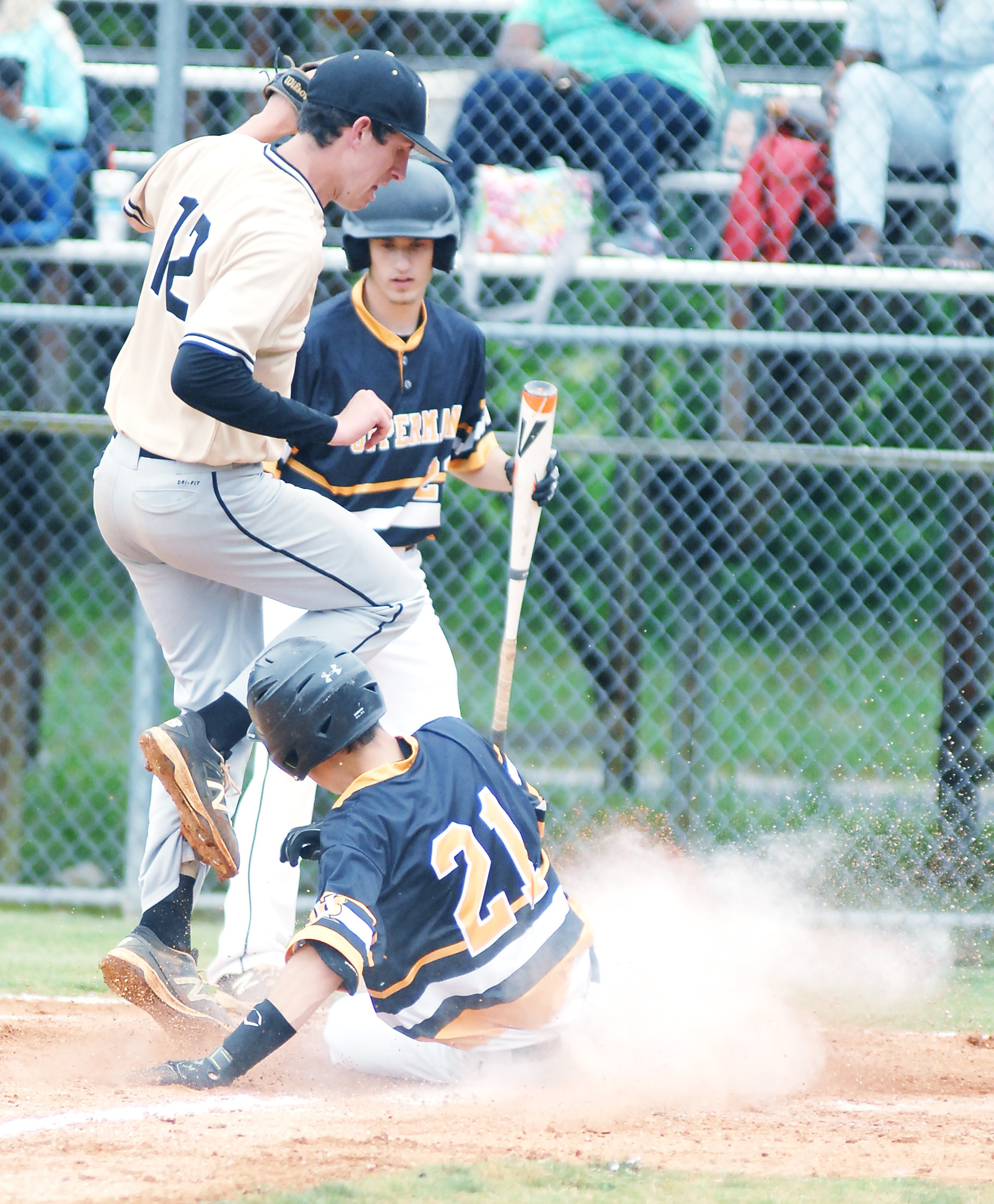Upperman's Dylan Yoder slides into home plate to score on a passed ...