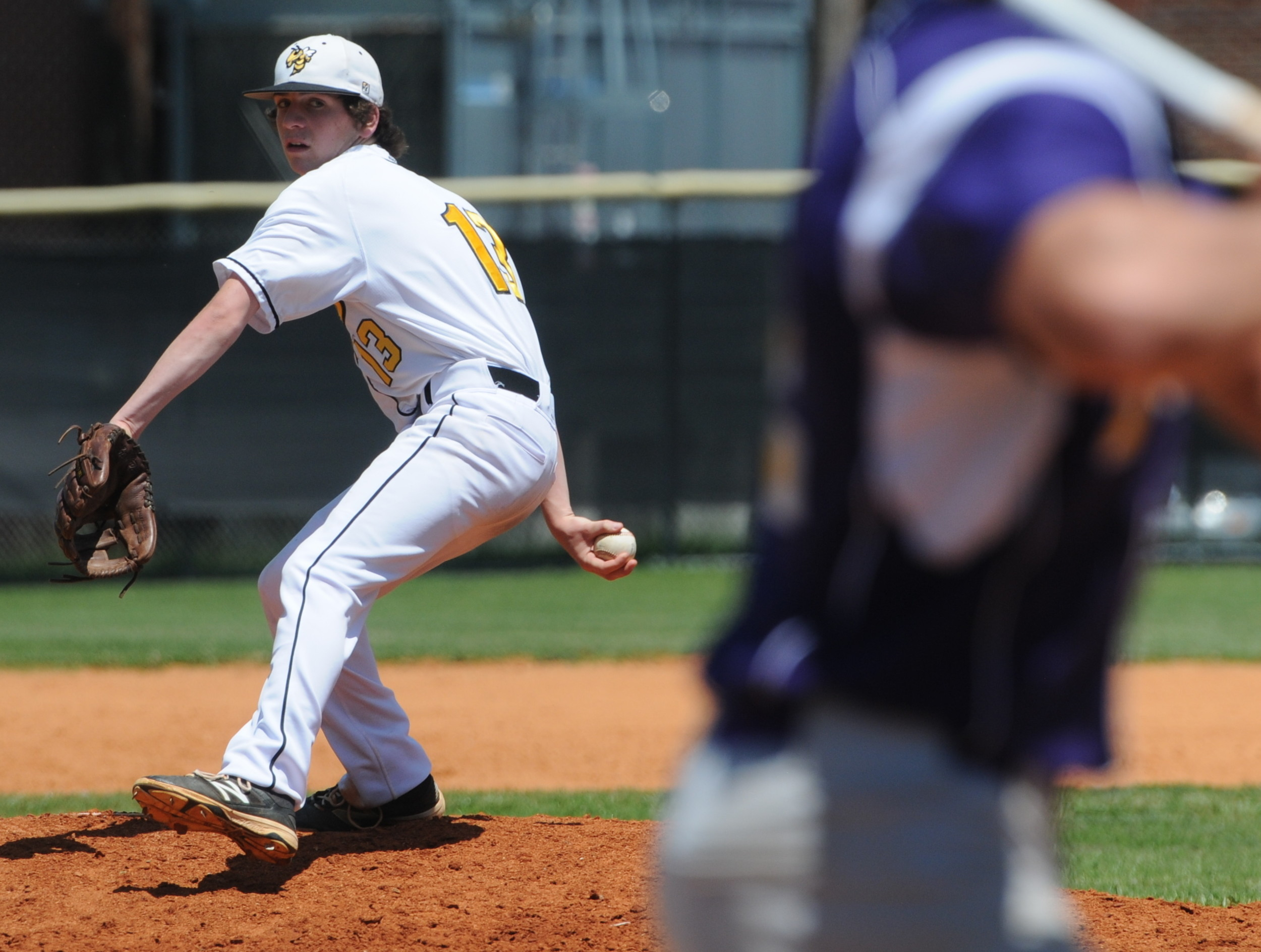 Upperman's Andrew Brown throws to the plate during the Bees' win over...