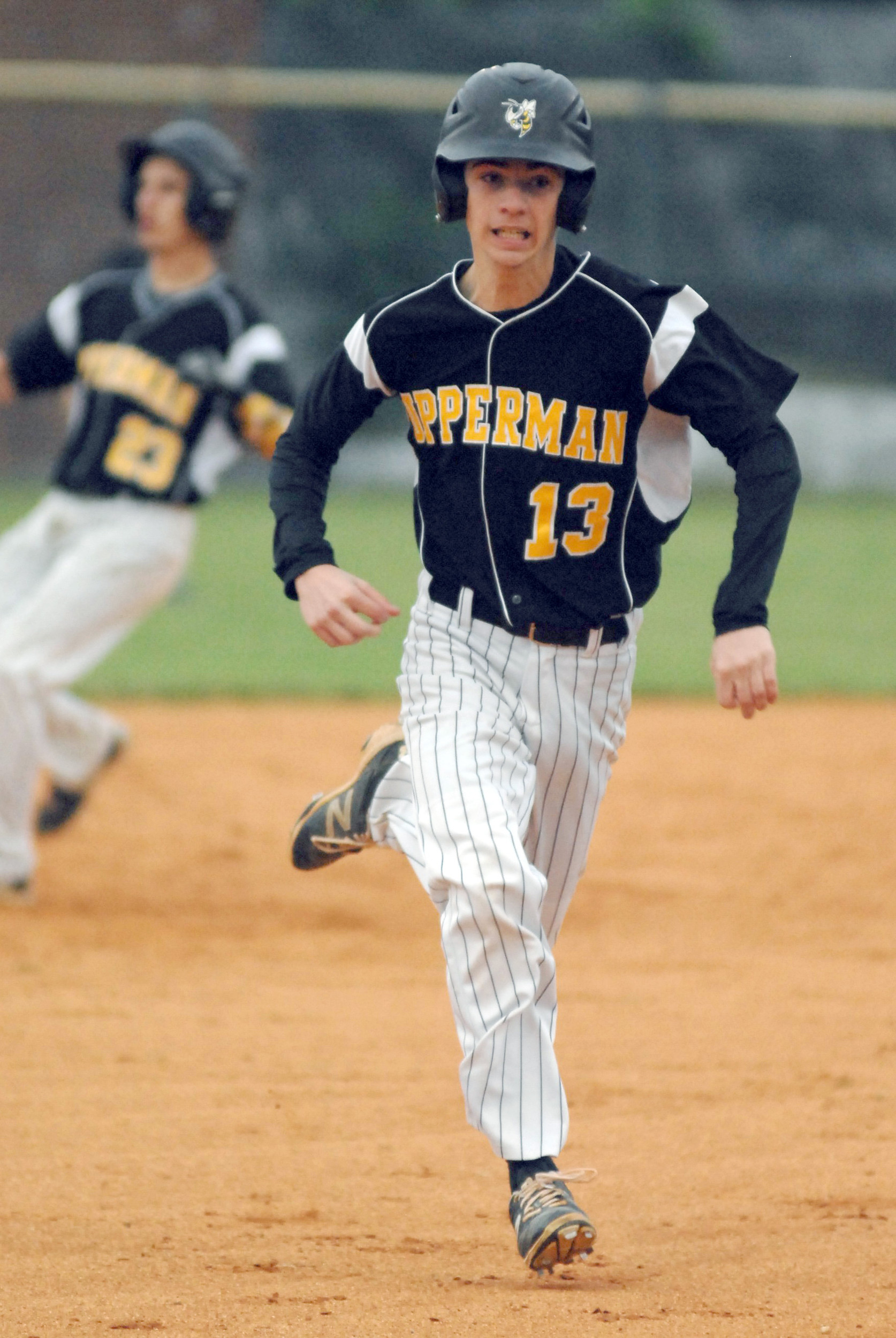 Upperman's Andrew Brown charges toward third, while Dristan Jared (23 ...