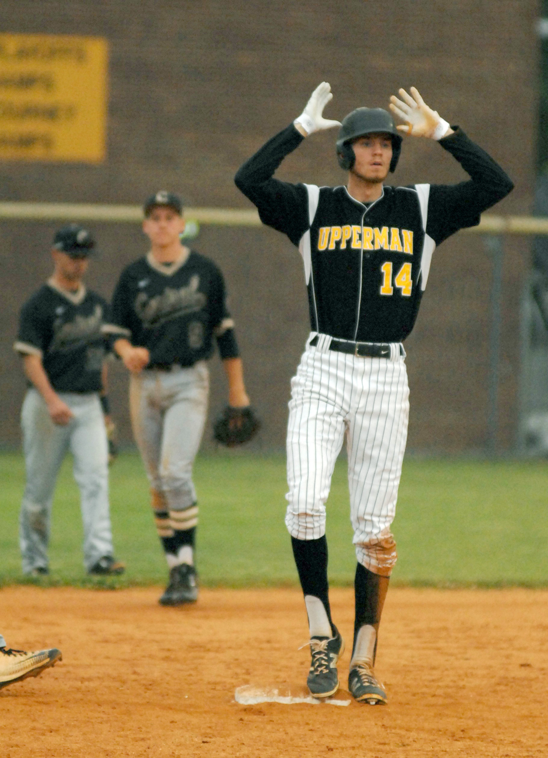 Upperman's Josh Endicott celebrates after a double during the Bees' 5...