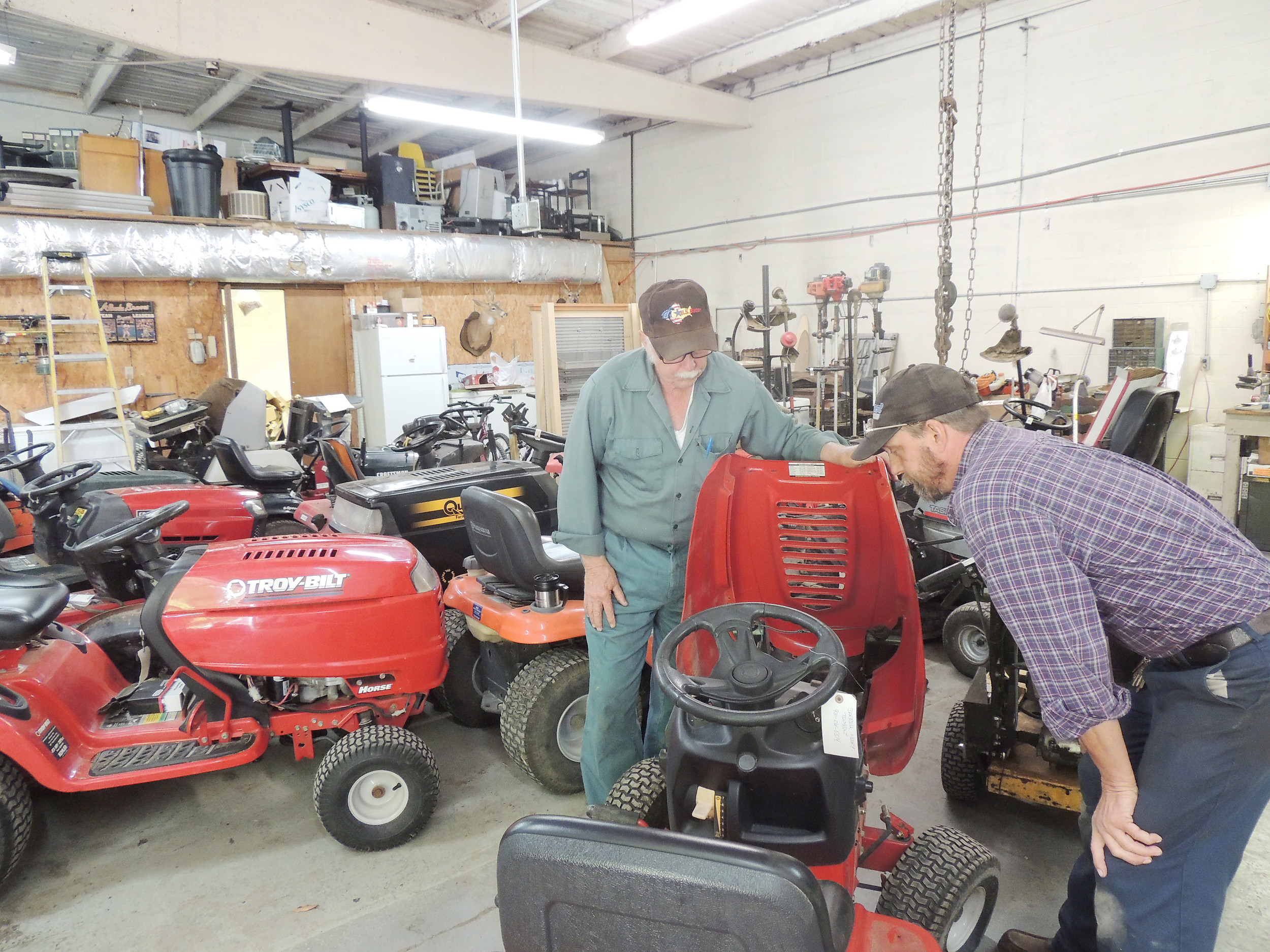 Small engine repair shop back open herald citizen for Small motor repair shop