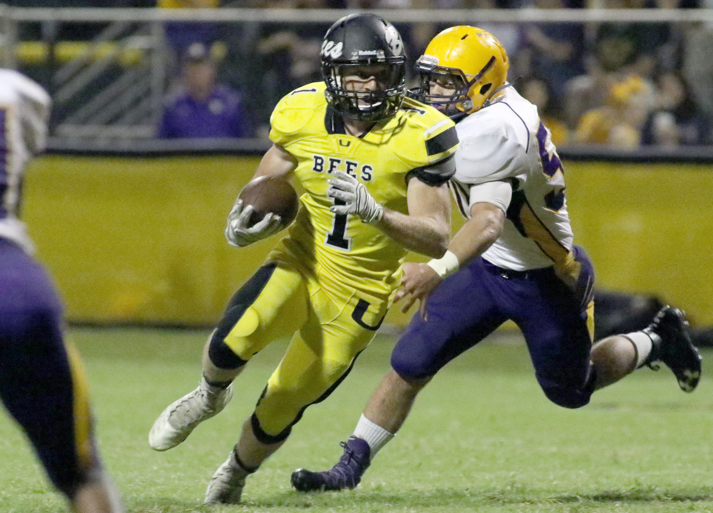 Upperman's Cole Pierce looks for running room during the Bees' game ...