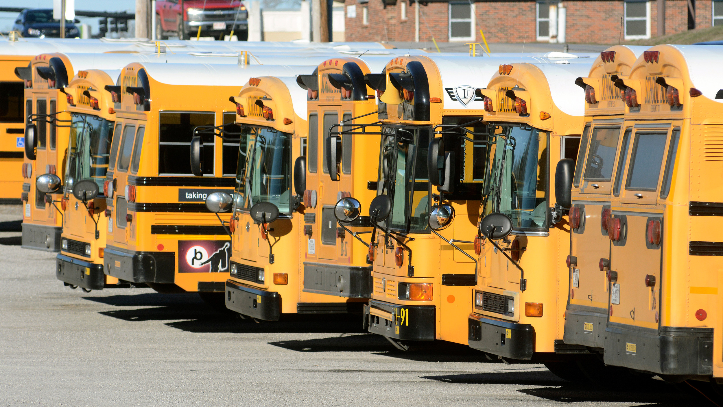 Putnam County school buses sit idle Thursday morning at the school bus lot  on Veterans Drive