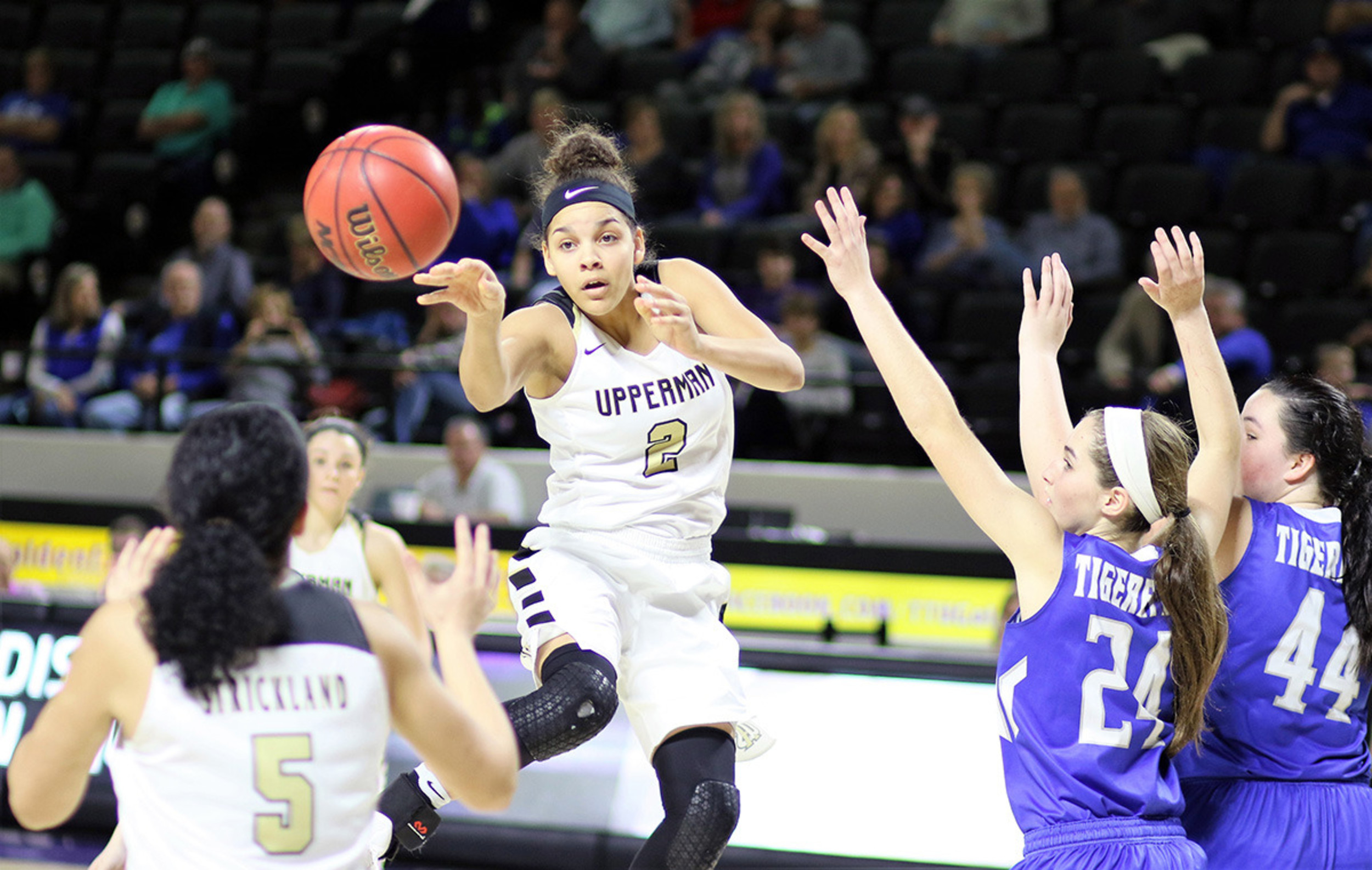 Upperman's Akira Levy dishes to teammate Lexie Strickland during the ...