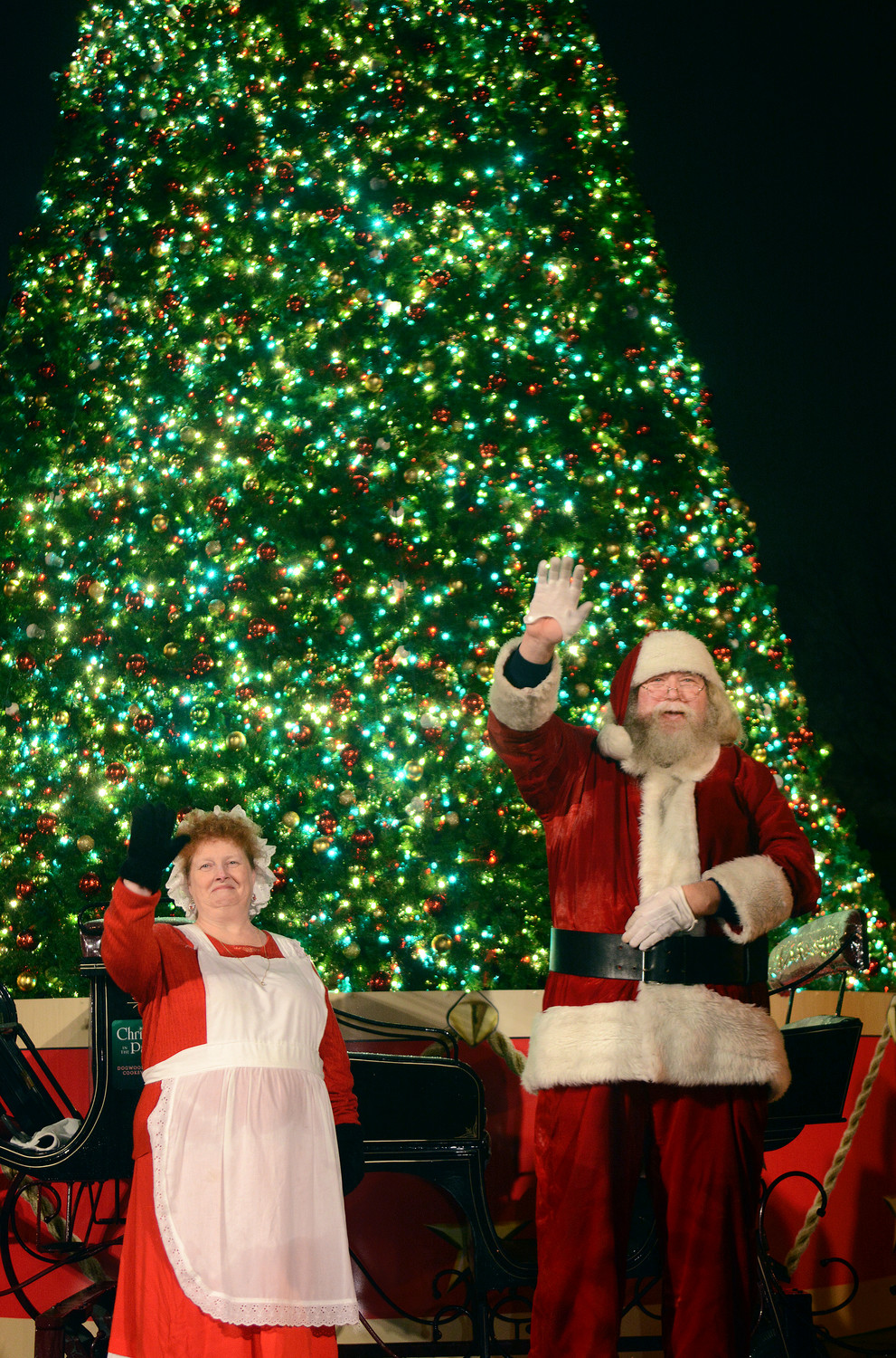 santa and mrs claus wave to the crowd during last years christmas in the park - Bbt Christmas Eve Hours