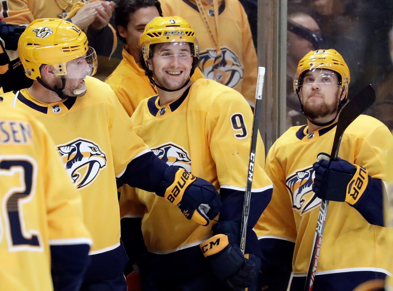 Nashville Predators left wing Filip Forsberg, of Sweden is congratulated by Mike Fisher and Viktor Arvidsson right of Sweden on the bench after Forsberg scored his second goal against the Colorado Avalanche during the third period in Game 1