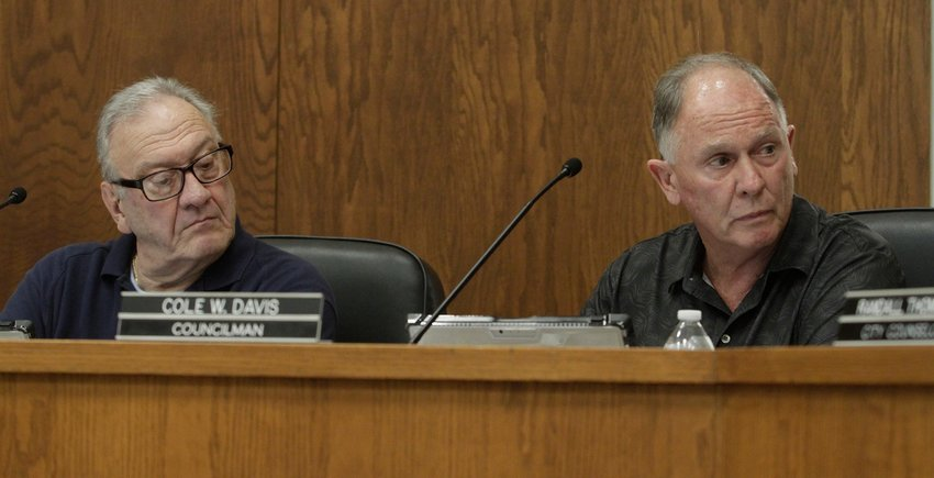 Moberly City Council members John Kimmons, left, and Cole Davis listen to city attorney Randall Thompson as he explains legal matters pertaining to a city ordinance during a Sept. 7 city council business meeting held at City Hall.