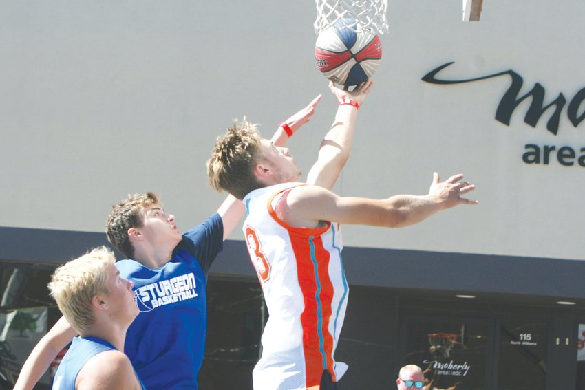 Carter Briscoe of Clark County goes for a layup during the Gus Macker 3-on-3 Basketball Tournament Saturday, Sept. 25, in Moberly. Theo Tate photo.