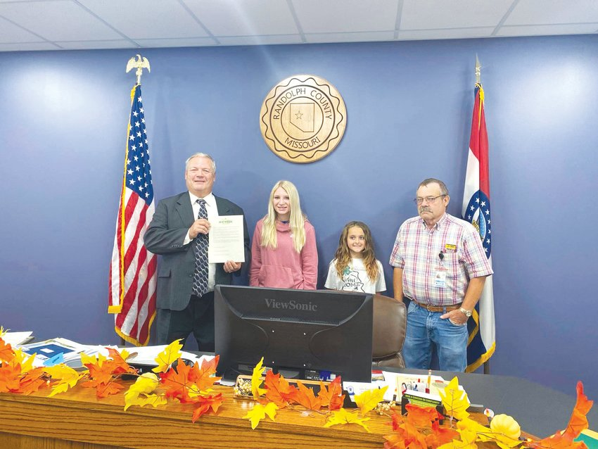 The Randolph County Commission signed a proclamation declaring Oct. 3-9 as National 4-H Week. Pictured, from left, are Presiding Commissioner John Truesdell, 4-H members Marilynn Ritter and Anna Drewery and Eastern Associate Commissioner John Tracy. Not pictured is Western Associate Commissioner John Hobbs.