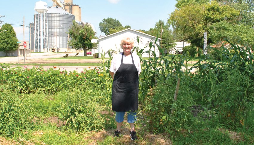 Joni Smith, owner of Front Street Market and Hume's community garden coordinator, stands before the plot across from her restaurant. Front Street Market doubles as a distribution center for community garden produce.